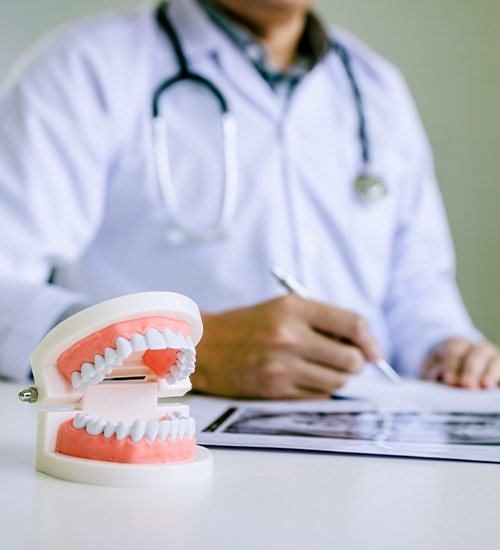 Dentist examining smile model and dental treatment plan