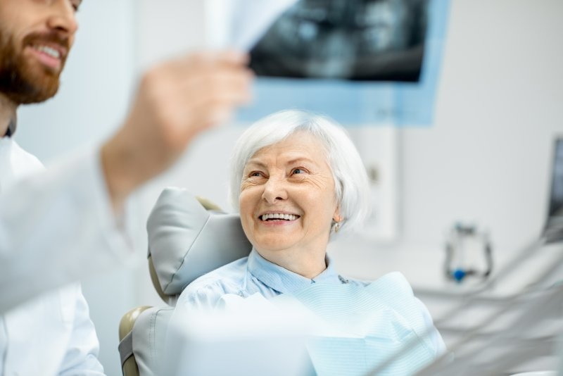 Dentist showing senior patient their X-ray